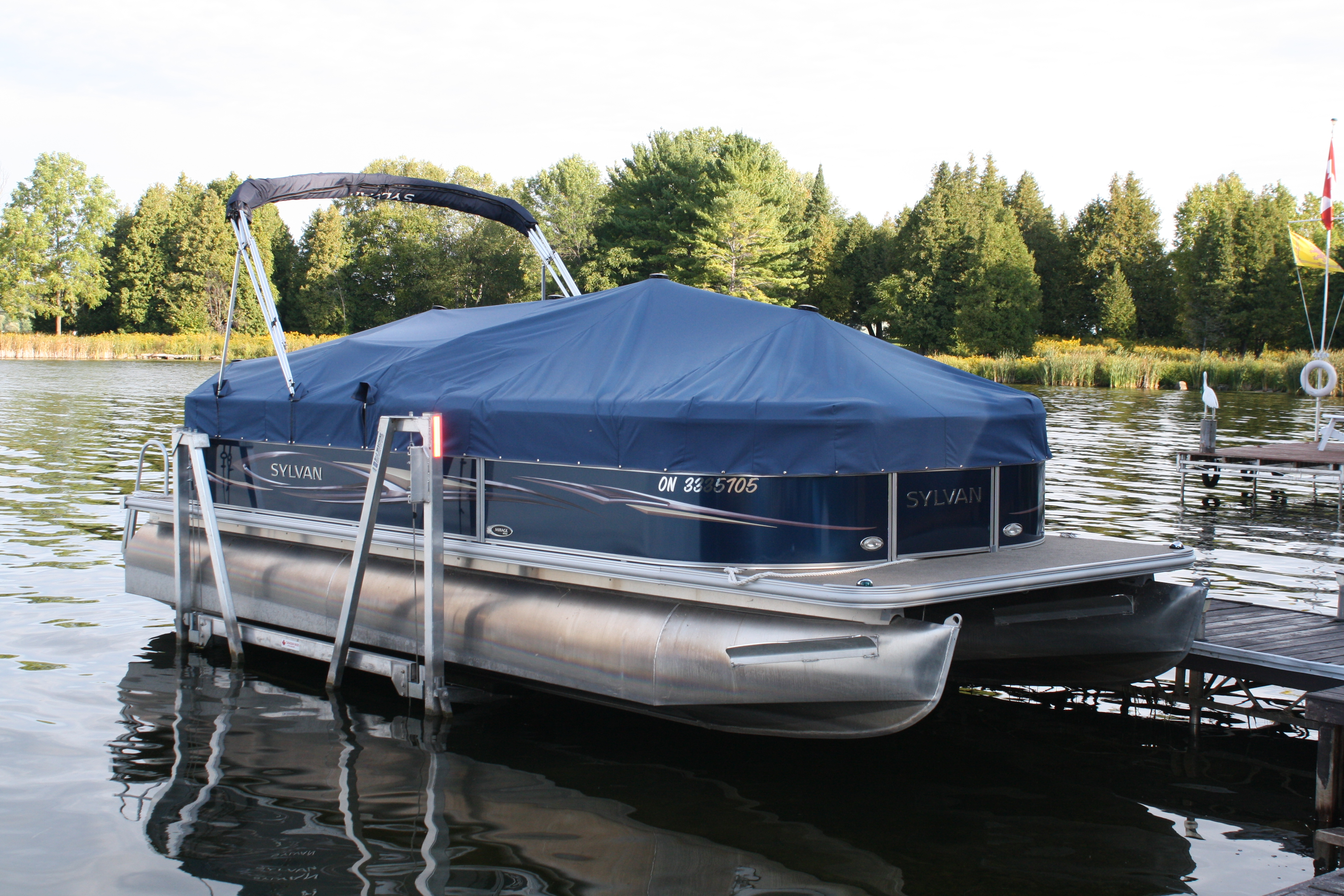 Pontoon boat lifts shallow water pontoon lifts r j for Boat lift motor covers