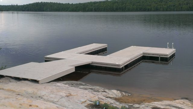 Permanent steel shore section to floating u shaped dock