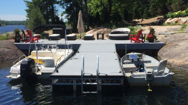 Aluminum framed floating dock with permanent shore section