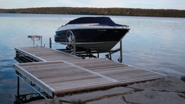 Cantilever Boat Lift beside Lift Up Step Dock