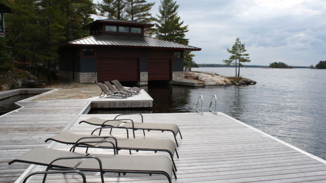 Boathouse with permanent lift up docks