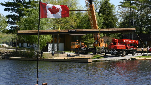 Crane Lifting Steel Floater into the water-Proudly Canadian Made