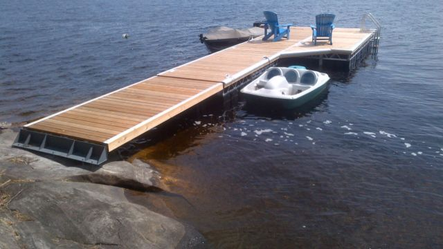 Floating dock with ramp and custom shore base plate