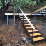 Steel stairs snd landing with wooded treads