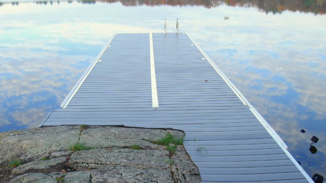 Lift up dock with shoreline profiled decking