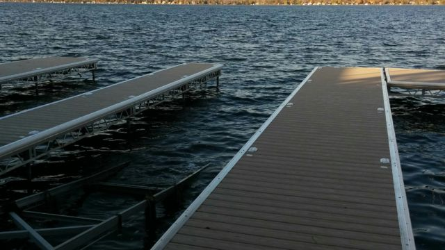 Lift up docks with lift up marine railway systems into boathouse