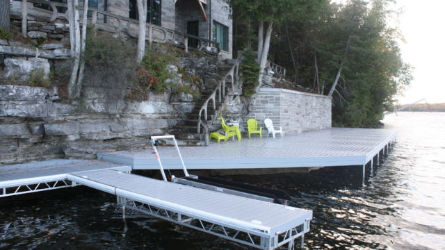 Pipe Dock for PWC Lift. Attached to permanent shore docks