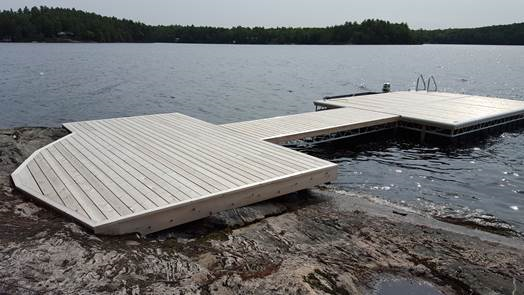 Floating Dock attached to permanent steel shore section, with cedar decking