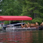 Cantilever Boat Lift with a Red Canopy