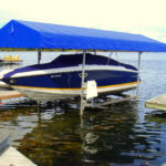 Cantilever Boat Lift with a Blue Canopy