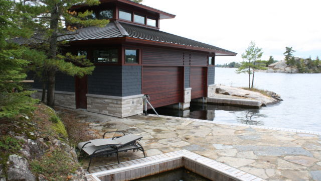Boathouse with permanet shoreline boardwalk and dock system