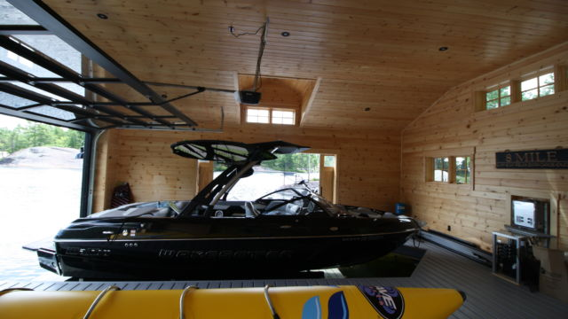 Boathouse with Hidden Beam Wet Slip Lifts