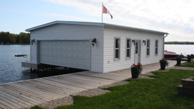 Completed Boathouse on steel piles with Wet Slip Lifts