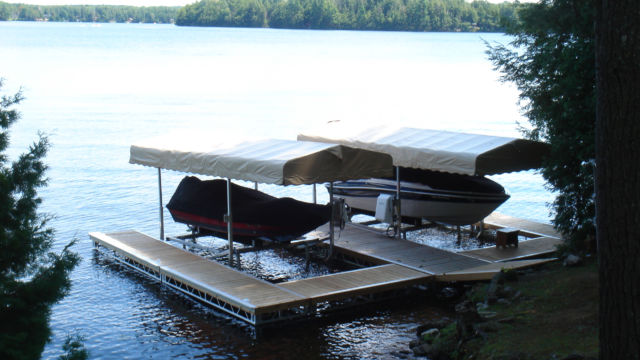 Pipe dock system with ramp sections and two Cantilever Boat Lifts